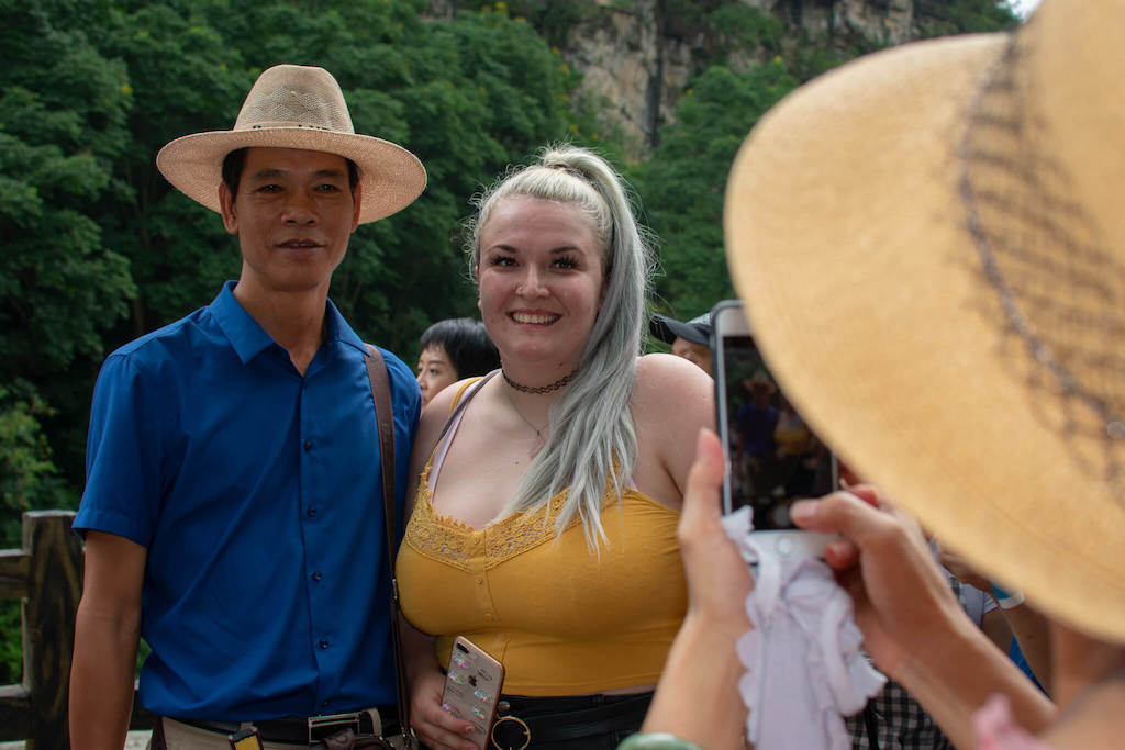 British girl having photo taken with Chinese locals in China