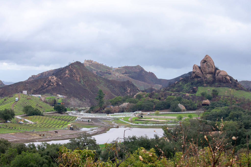 Areas of LA - Malibu on a rainy day with mountains, a lake and a farm