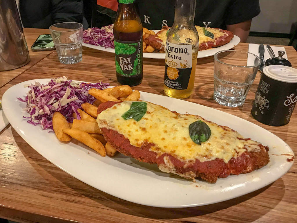 Melbourne Chicken Parma, breaded chicken with tomato sauce and cheese with chips and slaw