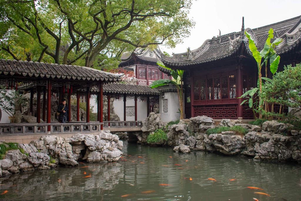 Shanghai Yu Garden, pond with koi fish and pavillion nestled in trees