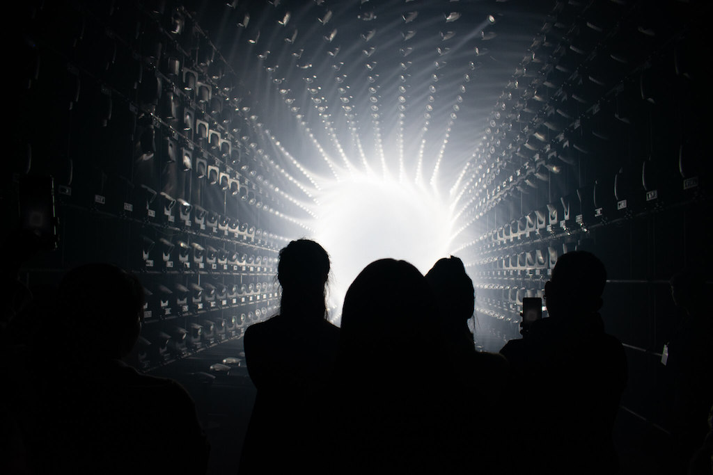 Shanghai teamLab Borderless, Silhouettes of people in front of bright white light, art museum in Shanghai