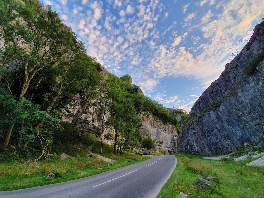 Weekend countryside breaks from London, road going between two cliff faces at Cheddar Gorge