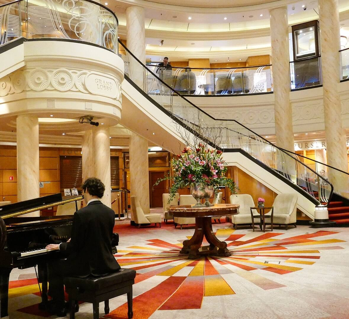 Offshore weekend breaks in the UK, light and luxury interior of a cruise ship lounge with piano player