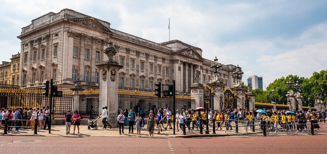Buckingham Palace with people outside of front gates, London itinerary
