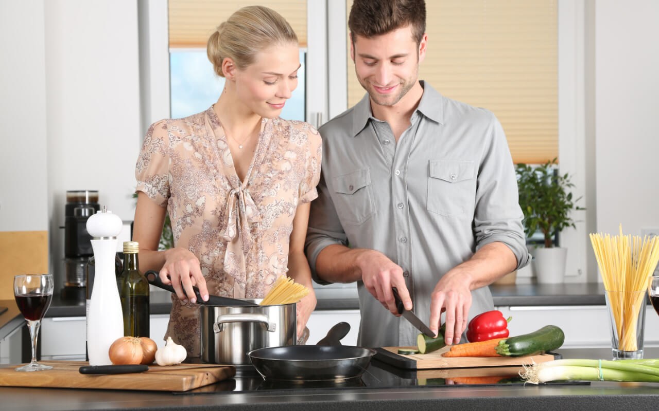 Couple cooking together during lockdown
