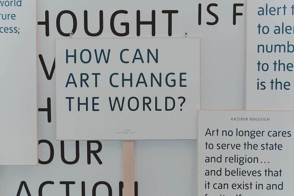 Poster reading: How can art change the world? At the Tate Modern London